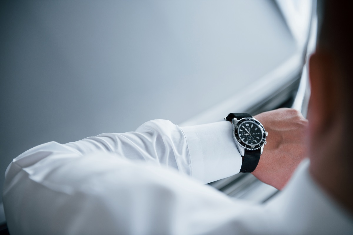 Man Checking His Luxury Watch